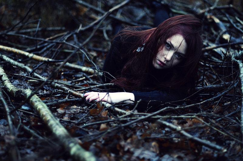girl,buried,forest